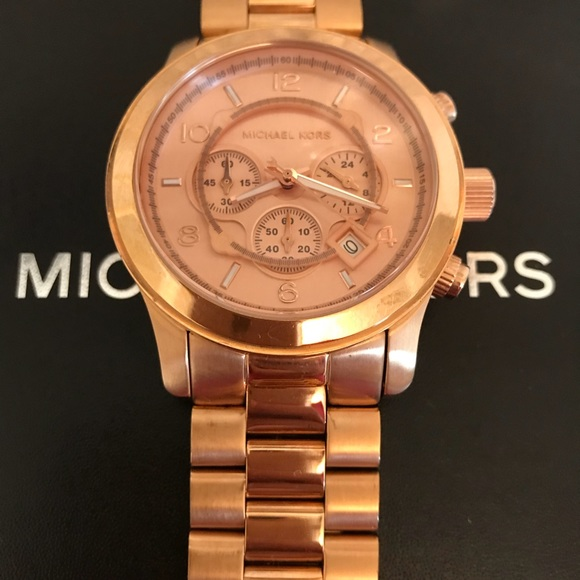 cadf50c1fd7e Michael Kors Runway Rose Gold Men s Watch. M 5ae75554a825a62e168d5875